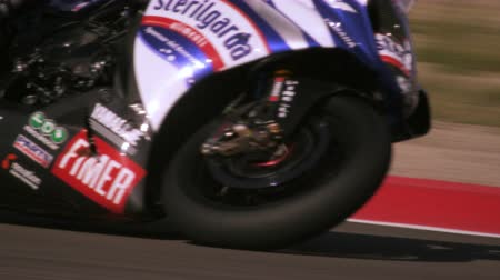 motor vehicle : Slow motion of a motorcycle racer on a racetrack