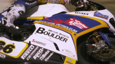 motorsports : Slow motion video of motorcycle racers competing at the race track Stock Footage