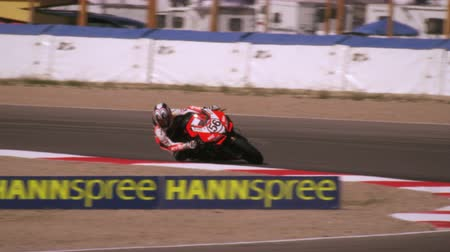 motorsports : Slow motion shot of motorcycle racers turning at a curve
