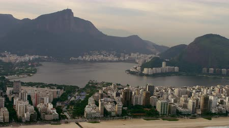 rio de janeiro state : Aerial shot of shoreline and sandy beach. Shot also includes city and lagoon. Stock Footage
