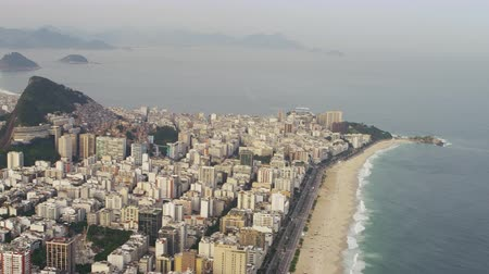 rio de janeiro state : Aerial shot of shoreline and coast. Rio city skyscrapers are included as well as the atlantic ocean.