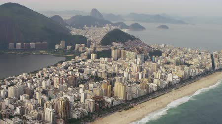 rio de janeiro state : Aerial shot of shoreline and coast. Rio city skyscrapers and lagoon are included as well as the atlantic ocean.