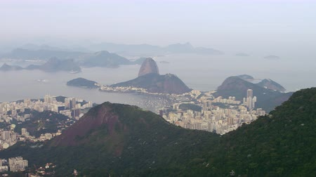 Рио : Aerial footage of rio de janeiro city that surrounds corcovado mountain. Shot includes atlantic ocean, lagoa, and sugarloaf mountain. Filmed during the day. Стоковые видеозаписи