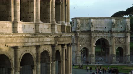 fenda : Slow motion shot of the Colosseum in the foreground and the Arch of Constantine in the background at dusk. Shot with a high speed camera on May 6,2012 in Rome,Italy