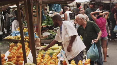 Рио : Slow motion shot of people buying produce in a market in Rio de Janeiro, Brazil