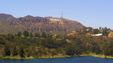 bilboard : Long distance static shot of the Hollywood sign with a body of water in the foreground. This shot was taken in June 2012