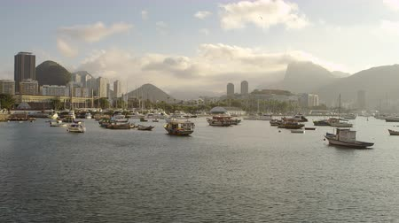 geological feature : Slow pan of boats anchored at a misty morning Guanabara Bay in Rio de Janeiro. Shot June 19, 2013. Stock Footage
