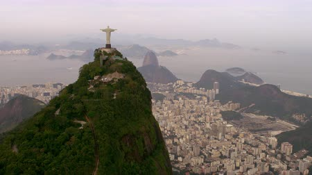 Рио : Aerial shot of landscape, landmarks, and architecture -Rio de Janeiro, Brazil. Cristo is evident in the shot as are the contrasting details of the city architecture and the natural surroundings.