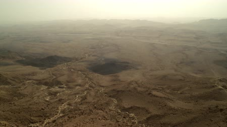 да : Panoramic of the desert floor of the Mitzpe Ramon Crater,in Israel. Move is Going right to left. Absolutely no vegetation. Shot with the Red One digital camera at 4k 4096 x 2304 resolution. 02252011