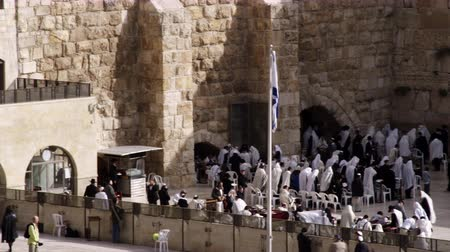 wailing : Wide panning shot of male Jews praying at the Western Wall Wailing Wall at a portion of what is left of Solomons Temple in Jerusalem,Israel. Shot with the Red One digital camera at 4k 4096 x 2304 resolution. 02262011 Stock Footage