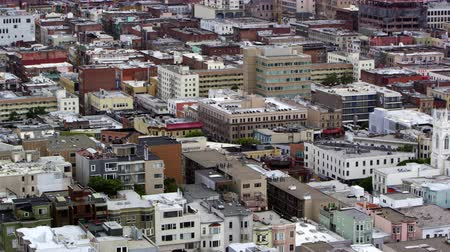 Pan of houses and buildings in Downtown San Francisco