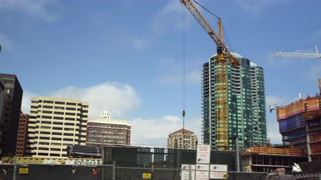 Pan of buildings under construction in San Francisco