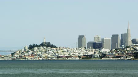 Pan of a bridge to San Franciscos city scape Stock Footage