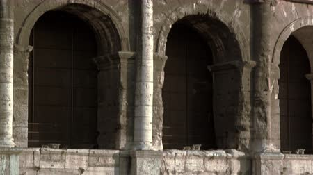 crevice : Detailed upward tilt of the crevices of each stone in the Colosseum wall. Shot on May 6,2012 in Rome,Italy