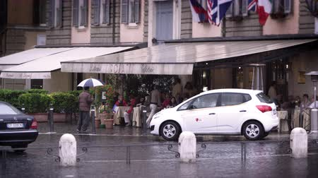 restaurante : Slow motion footage of a roman cafe filled with people during a rainy day. Shot with a high speed camera on May 7,2012 in Rome,Italy Stock Footage