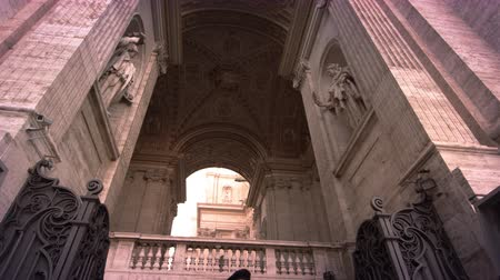 vigilant : Tilt up from Swiss Guards to stone arches and sculptures of St Peters and tilt down again. Filmed in Rome,Italy on May 8,2012