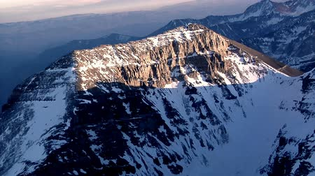 wilderness : Aerial shot of snow-capped red mountains in Utah. This shot was taken while the videographer was on board a plane. Stock Footage