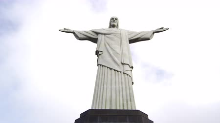rio de janeiro state : Low-angle pan of Rio de Janeiros monumental sculpture of Christ the Redeemer atop Corcovado Mountain. Filmed June 24, 2013.