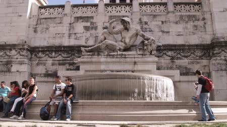 pro government : A wide shot of tourists sitting around a fountain in Rome Italy. Stock Footage