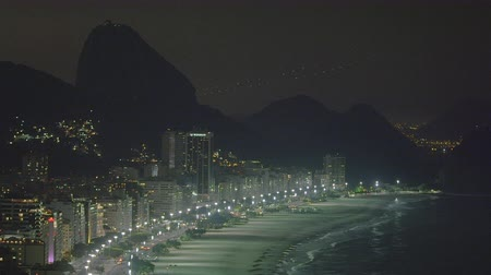 бразильский : Pan of Rio de Janeiro coastline in Brazil taken at night Стоковые видеозаписи
