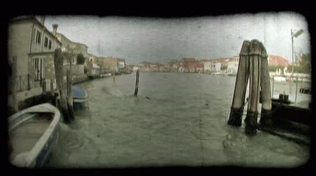 A shot of the docks on a Venice canal. Vintage stylized video clip. Stock Footage