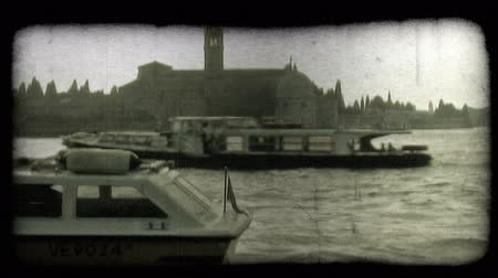 A shot of a Venice canal at sunset. Vintage stylized video clip. Stock Footage