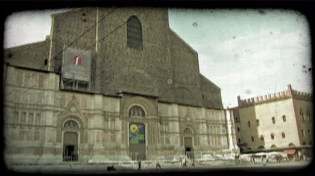 A wide shot of people walking through an Italian plaza. Vintage stylized video clip.