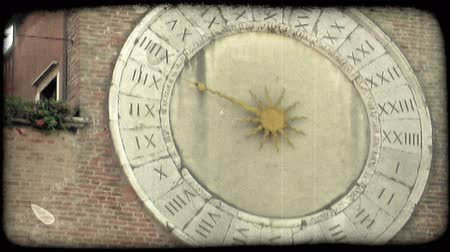 Shot of a 24 hour analog clock in Italy. Vintage stylized video clip.