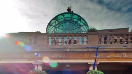 covent : Time-lapse of a big red building at Covent Garden in London, England. Filmed in October 2011. Panning shot.