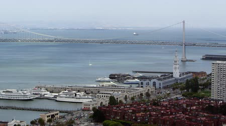 Day view of San Franciscos Bay Bridge and buildings Stock Footage