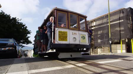 Daytime street view of a Trolley full of tourists, driving down the street in San Francisco Stock Footage