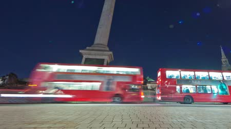 talapzat : Tracking time-lapse of Nelsons Column in Trafalgar Square, London. Traffic is passing by around the roundabout. Filmed in October 2011. Panning shot.