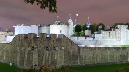 old dungeons : Time-lapse distant shot in the evening of the Tower of London in London, England. Filmed in October 2011. Cropped.