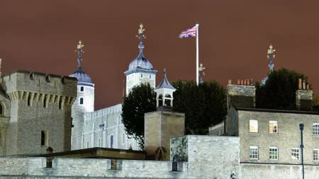 old dungeons : Time-lapse close-up shot in the evening of the Tower of London in London, England. Filmed in October 2011. Panning shot. Stock Footage