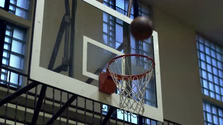 abroncs : Close-up slow motion shot of a basketball shot going through the net; nothing-but-net. Stock mozgókép