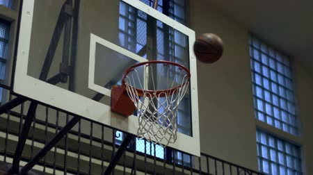 abroncs : Close-up slow motion shot of a completed basketball shot. Stock mozgókép