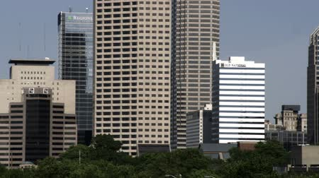 us bank tower : A close-up left panning shot of the Indianapolis that shows more detail in the smaller skyscrapers. Stock Footage