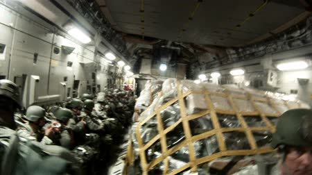 samoloty : Shot of the interior of a plane with soldiers and cargo preparing for a parachute jump. Part of training with the Green Beret United States Army Special Forces. Wideo