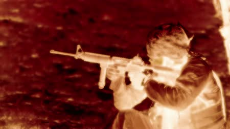 sziám : Negative static shot of soldier shooting M4 rifle at range while kneeling. Green Beret United States Army Special Forces.