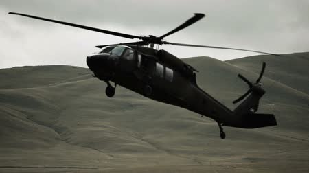 copter : Shot of Black Hawk helicopter coming in to land in field. Green Beret United States Army Special Forces.