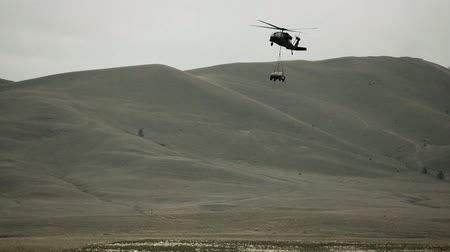 sas : Shot of Black Hawk helicopter hauling in Humvee. Green Beret United States Army Special Forces.