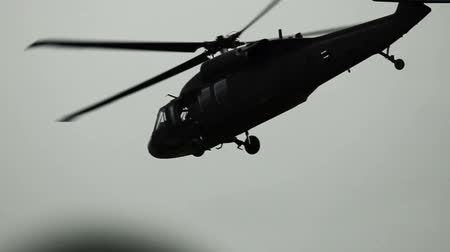 sas : Shot of Black Hawk helicopter flying byaway. Green Beret United States Army Special Forces.
