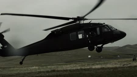 copter : Shot of Black Hawk helicopter landing in field with water droplets hitting lens. Green Beret United States Army Special Forces.