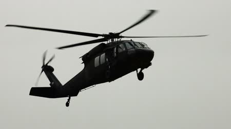 sas : Close up shot of Black Hawk helicopter approaching. Green Beret United States Army Special Forces.