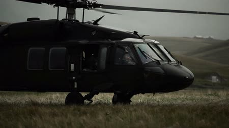 war : Shot from field of Black Hawk taking off. Green Beret United States Army Special Forces.