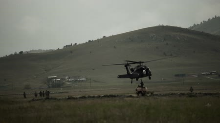sas : Shot of soldiers attaching fuel tank to Black Hawk helicopter. Green Beret United States Army Special Forces.