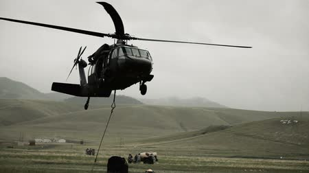 sas : Shot from field of Black Hawk helicopter hauling off cargo. Green Beret United States Army Special Forces.