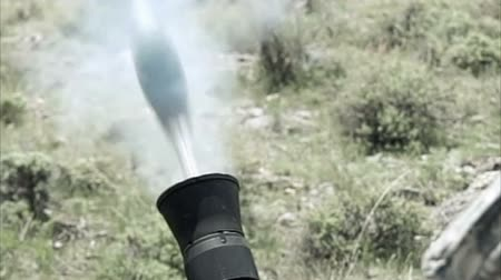 robbanás : Slow motion clip of mortar firing. Green Beret United States Army Special Forces.