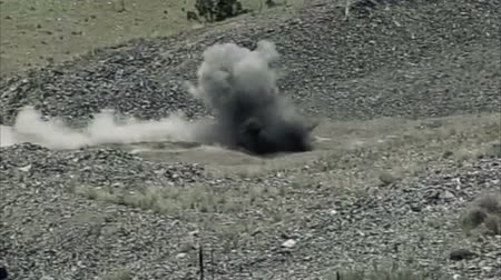 gyújtás : Small explosion in slow motion at blasting area. Green Beret United States Army Special Forces.