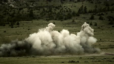 gyújtás : Super slow motion fiery explosion line at blasting area. Green Beret United States Army Special Forces.